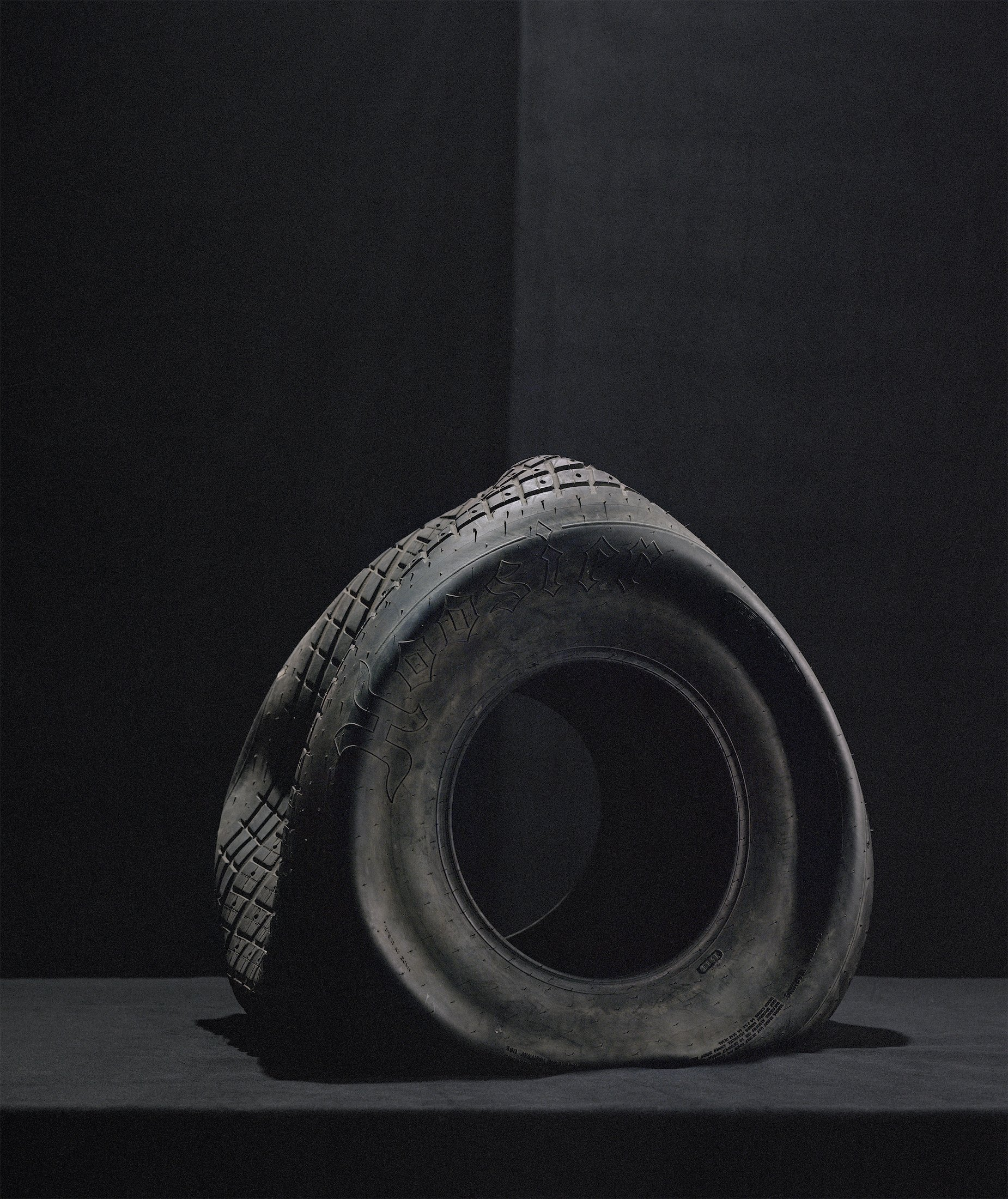 Still Life with Tire II, 2019, archival pigment print, 56.5 x 47.5 in.