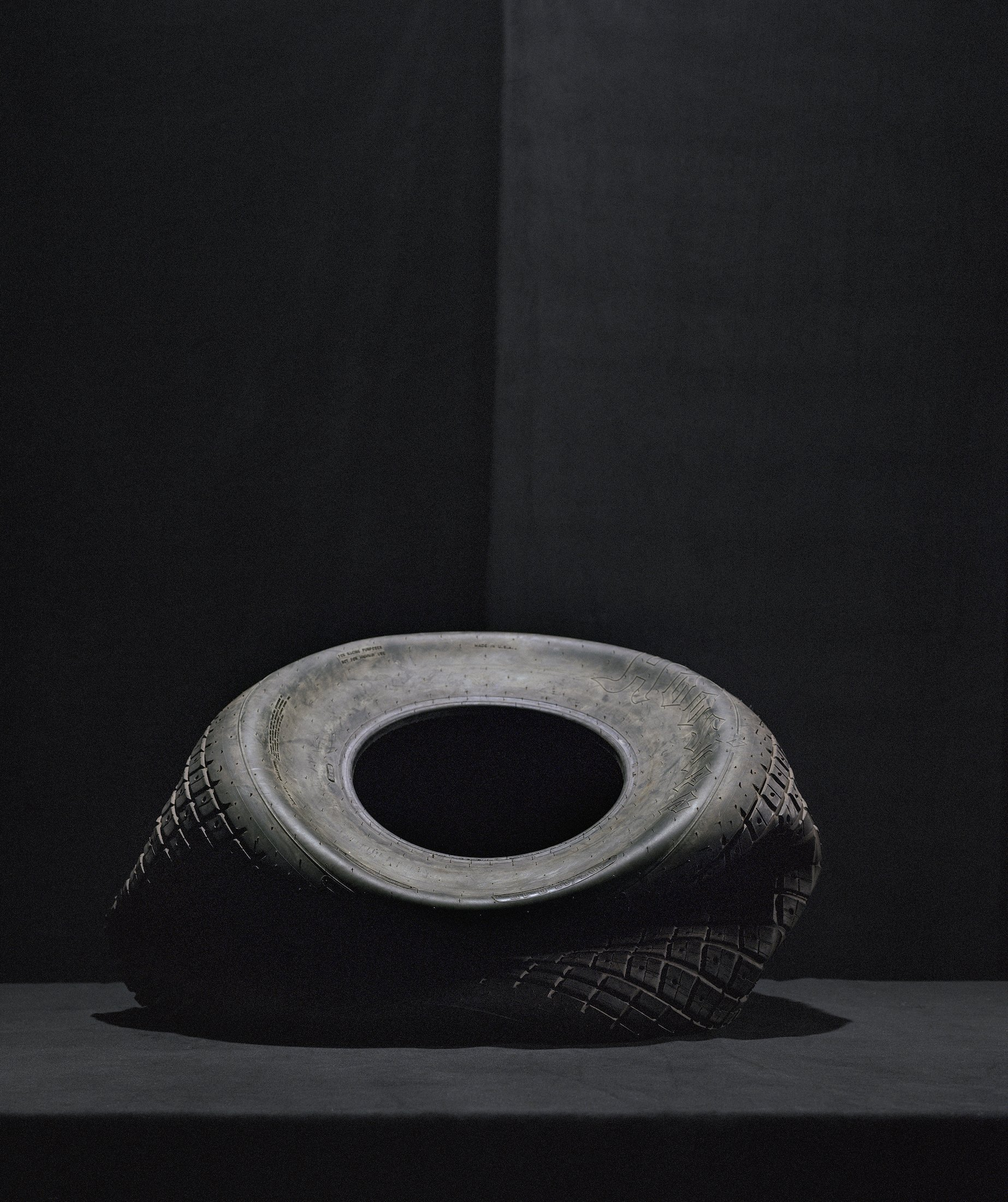Still Life with Tire I, 2019, archival pigment print, 56.5 x 47.5 in